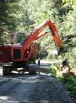 Working on the road...moving some wood in the Toba Valley.